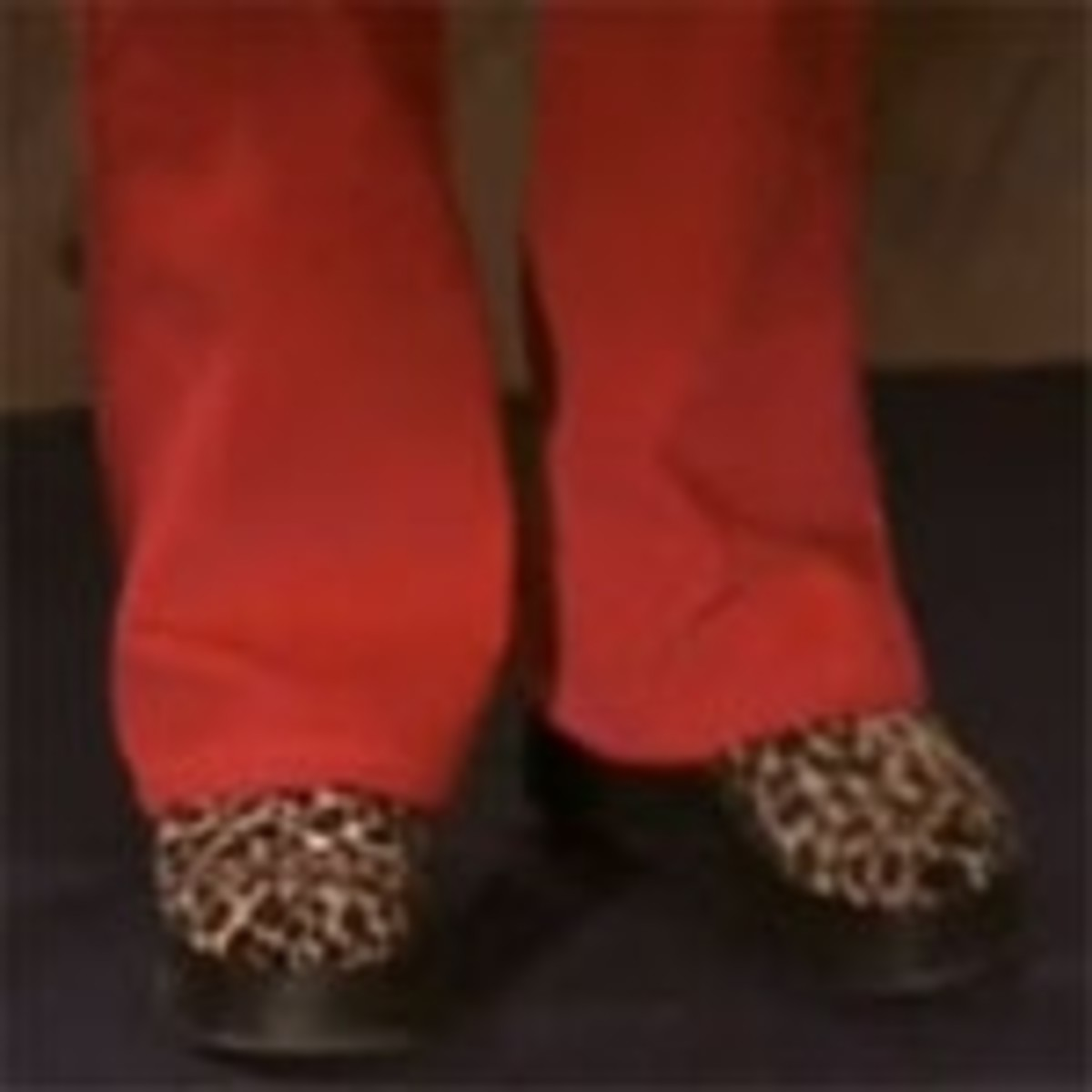 She also dons platform heels. Check out this rockin' leopard print ones!