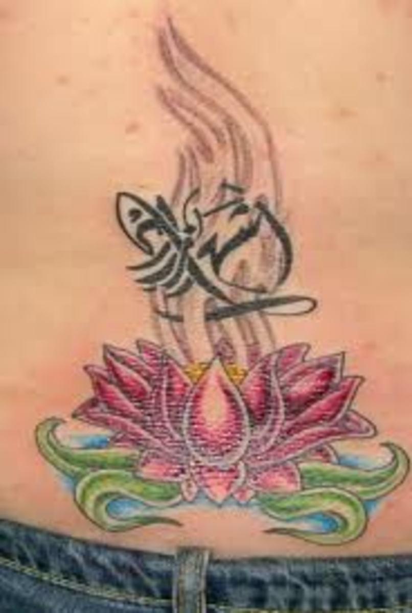Lotus and Zodiac lower back tattoo design