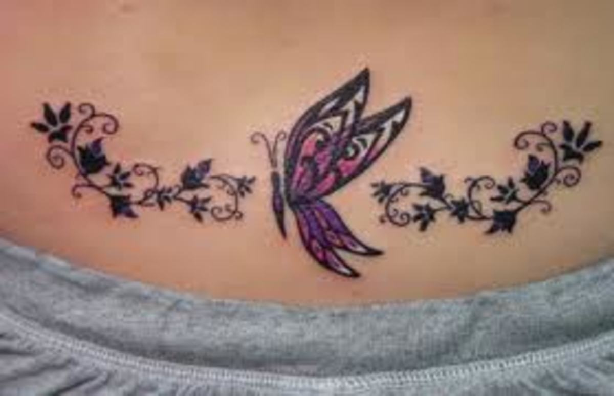 Beautiful lower back butterfly tattoo
