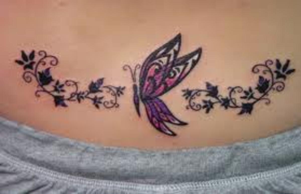Beautiful lower back butterfly tattoo
