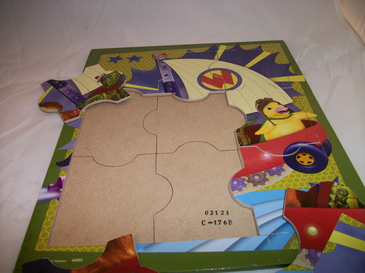 9-piece connecting puzzle, with outline of pieces drawn in to make puzzle easier