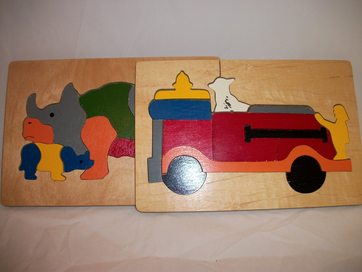 Small wood connecting puzzles.  Rhino and baby, and fire engine with fire dog.