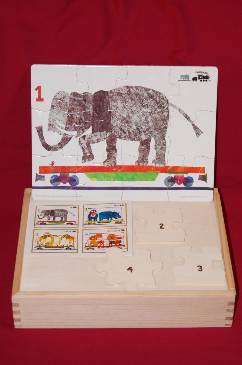 Boxed set of four 12-piece interlocking puzzles.  These are difficult, with a lot of white background, and slightly abstract animals.