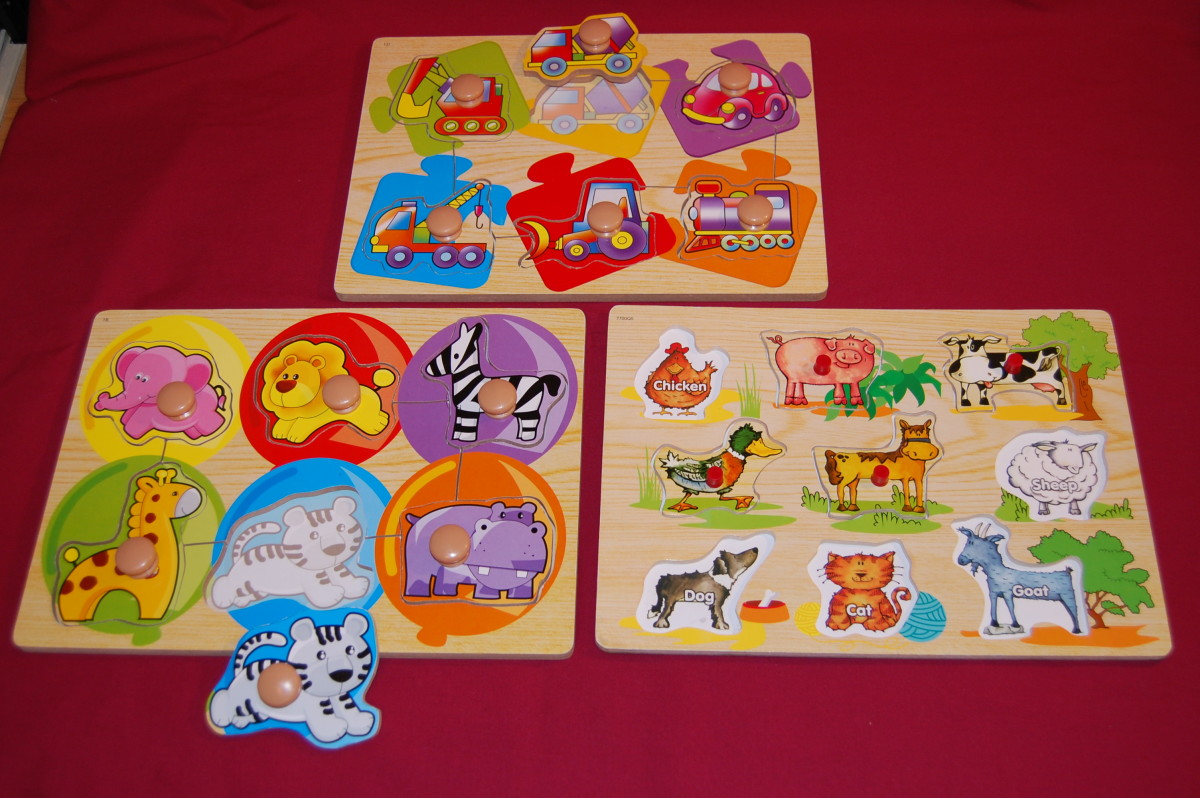 Non-connecting puzzles with knobs.  Six-piece puzzles with large knobs, and nine-piece farm animals puzzle with small knobs.