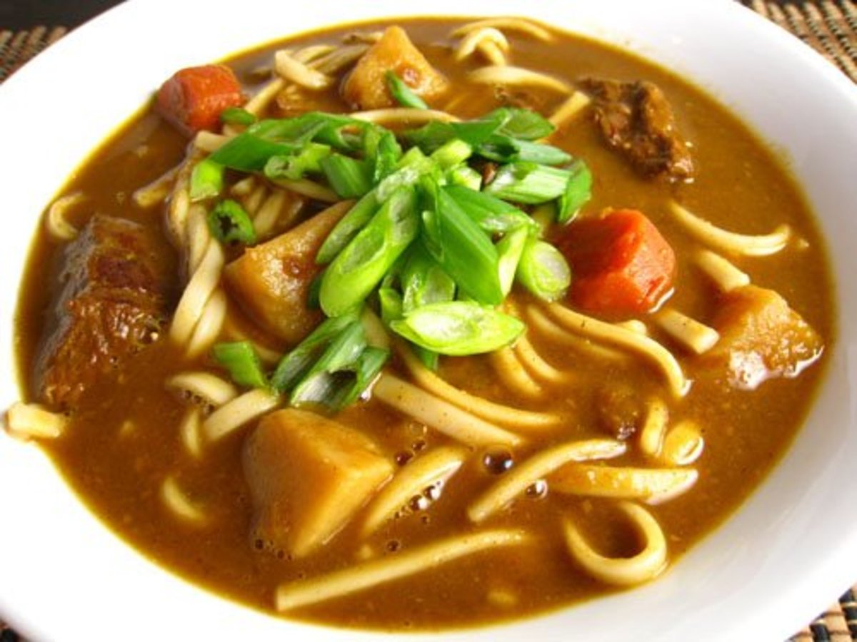 Udon is a noodle dish made from wheat noodles that uses kelp or tuna flakes to get the soup stock (dashi). In curry udon like here, one can add curry to the udon to enjoy the curry more like a soup.