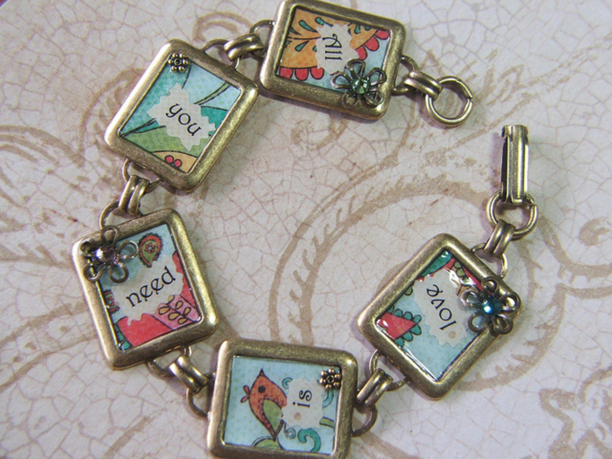 Resin over scrapbook paper in a victorian collage bracelet