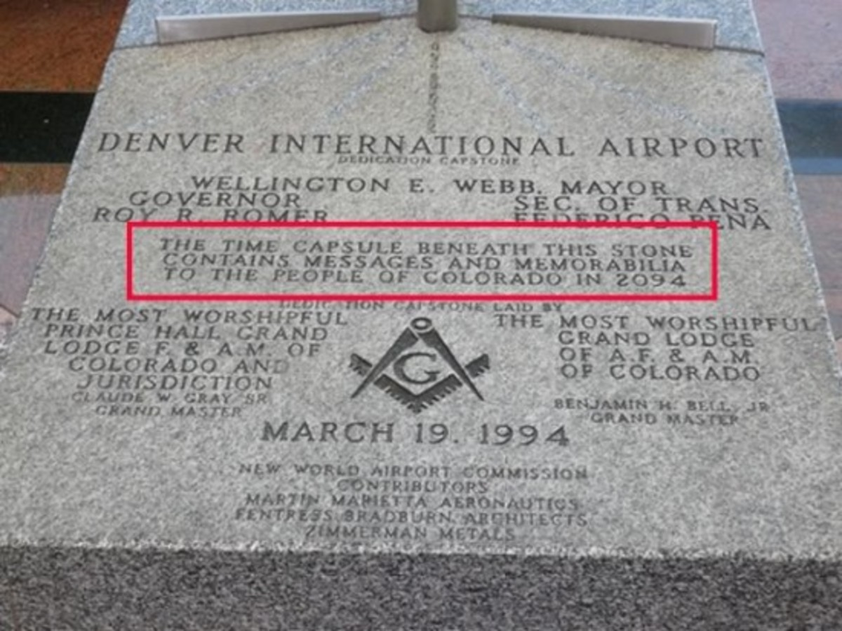"""The Masonic capstone a time capsule within the airport.  The capsule contains the Masonic symbol as well as the words """"New World Airport Commission""""."""