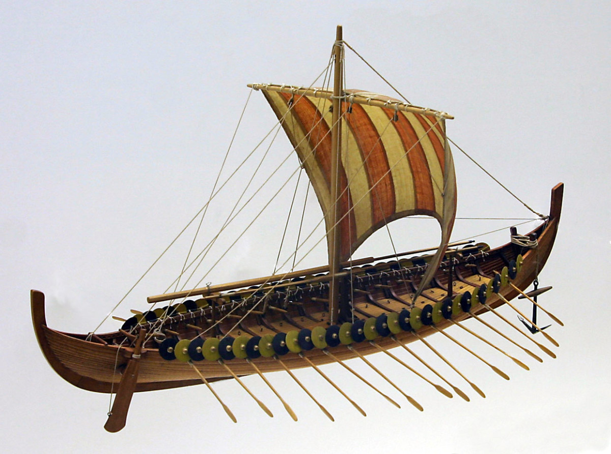 A model of the Gokstad ship. The shields would have been taken in before the oars were run out for rowing. Also, if the sail was up and full with the wind there would be no need for the oars to be in their holes.  Modeller's license.