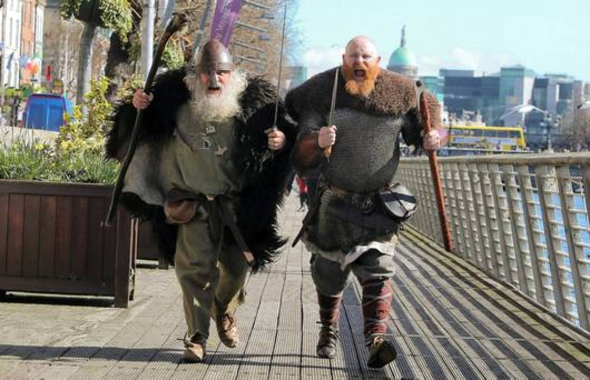 A pair of seasoned re-enactors mount a charge on the newspaper cameraman in Viking Week, Dublin,