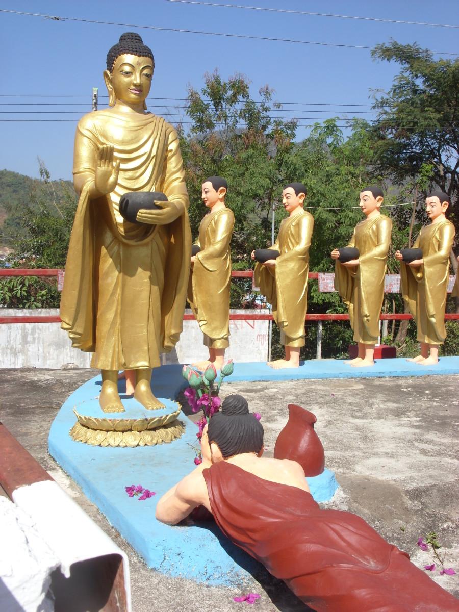 Statues of Buddha and followers