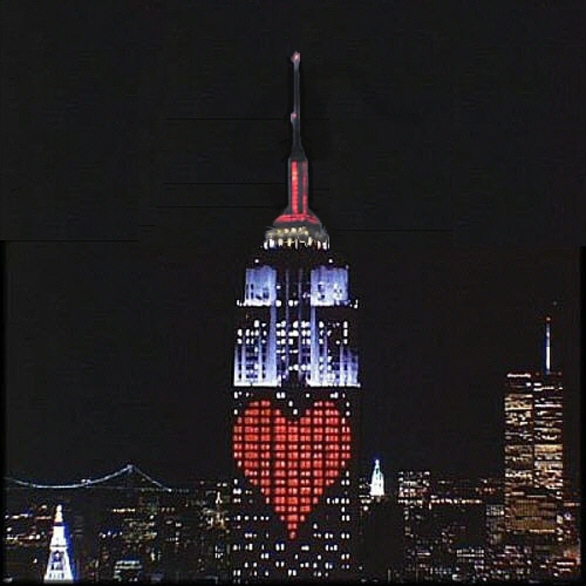 An illuminated heart on The Empire State Building on St Valentine's Day in 'Sleepless in Seattle' - a romantic signal which is seen by Annie Reed - a signal she cannot ignore