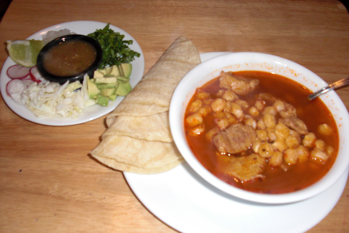 Here is my Mexican posole served with cabbage, cilantro, onions, avocado, radishes, lime, tomatillo chile and soft corn tortillas.  This is one of my all time favorite meals.