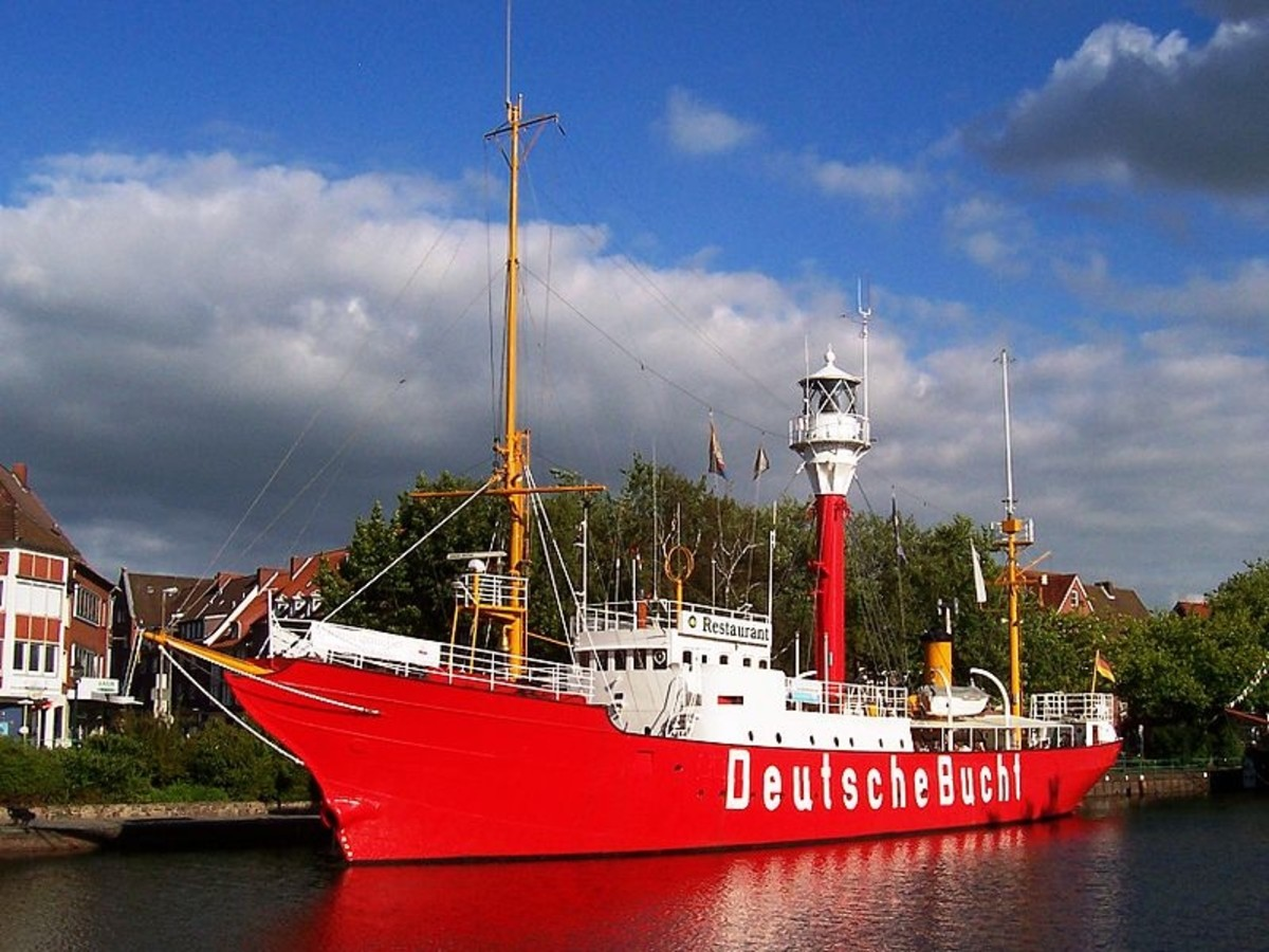 """Light vessel (Feuerschiff) Amrumbank was decommissioned in 1983 and converted into a maritime museum and restaurant in Emden, Germany. Painted on its side is the Amrumbank's last post before retirement: """"DeutscheBuch"""", or """"German Bight/Bay""""."""