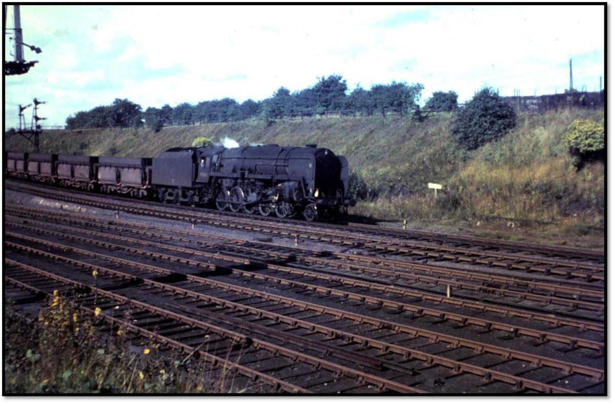 Just to show what a 9F 2-10-0 was used for - an unidentified member of the class drifts downhill through South Pelaw Jct with a train of empty 56 ton iron ore hoppers on her way back to Tyne Dock to be reloaded