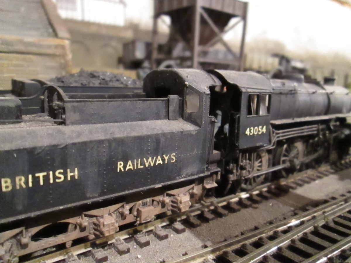 Darlington-built LMS designed Ivatt Class 4MT 43054 of Darlington (51A) shares heavy traffic with the WD 2-8-0 and Q6 0-8-0 classes as well as faster fitted traffic schedules (Bachmann model re-numbered and weathered)