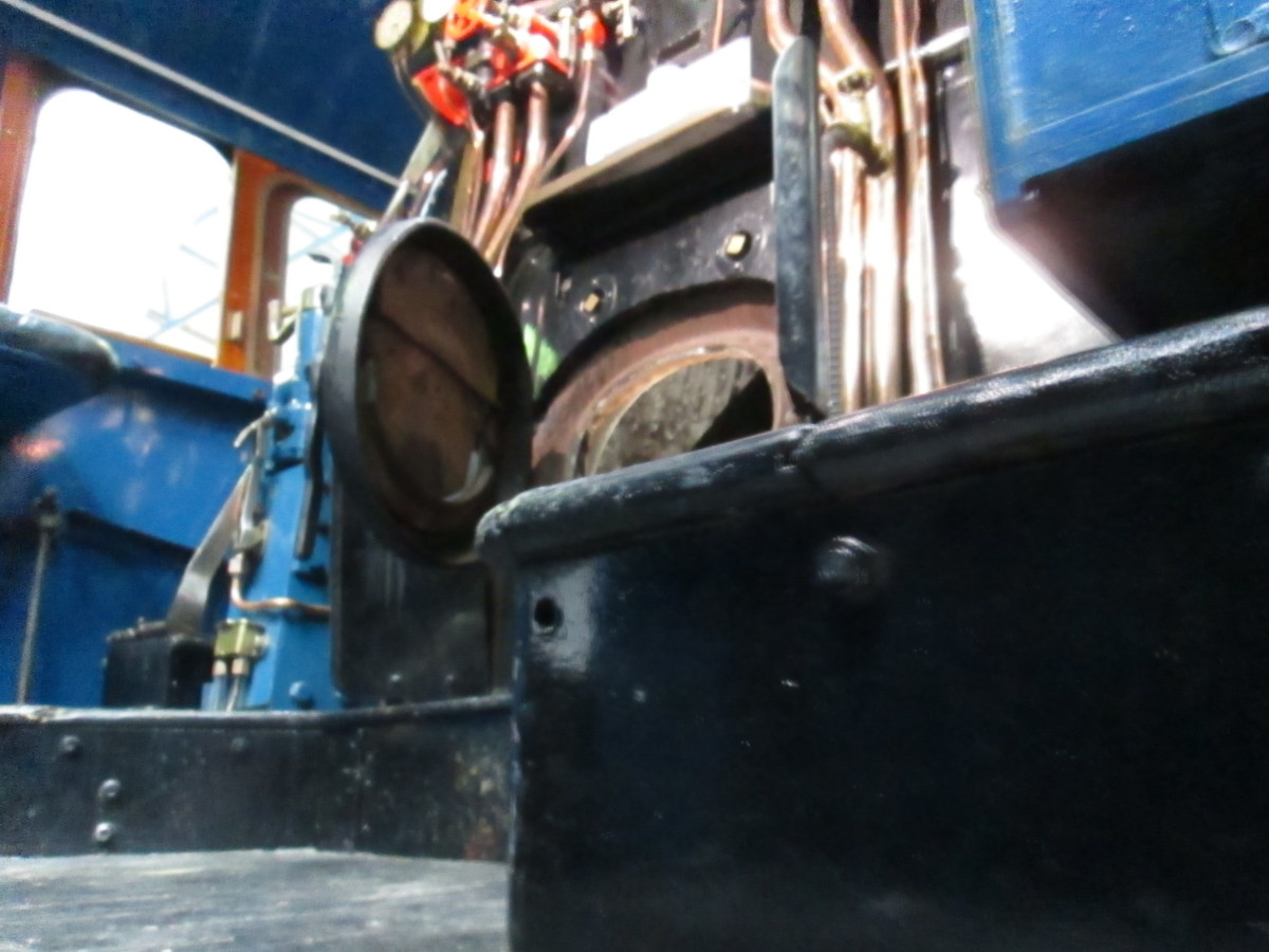 A look up from the other side of the cab upward to the firebox door