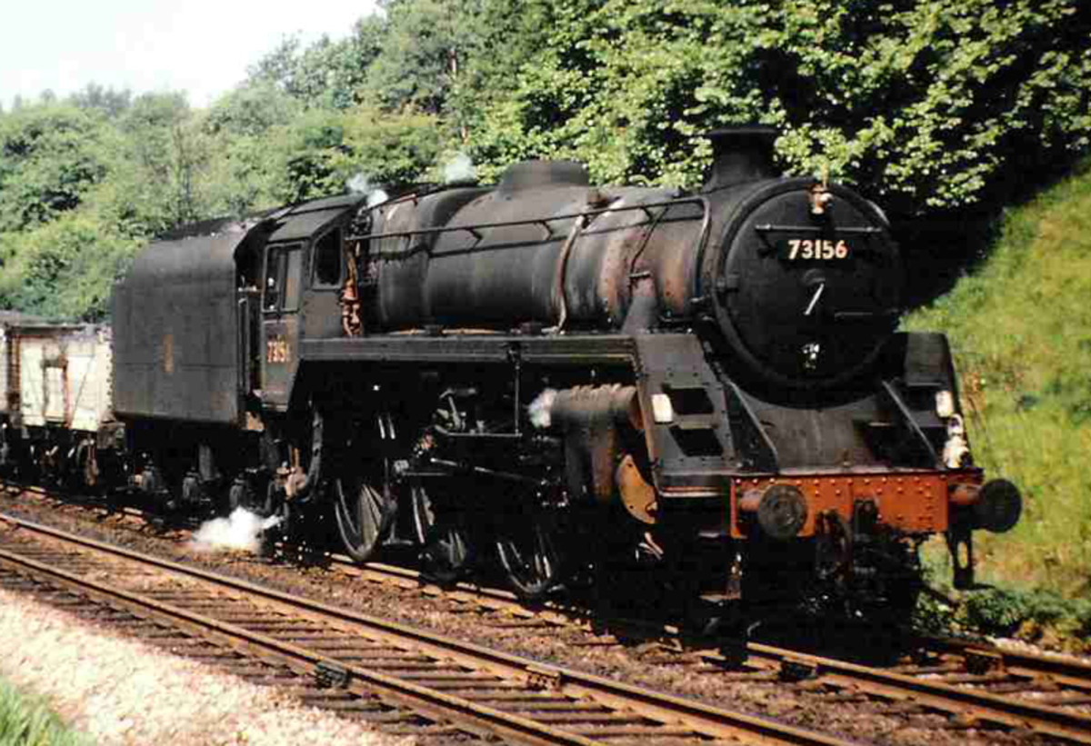 Hard at work in the dying days of steam, Class 5 4-8-0 (successor of the LMS 'Black 5') 73156 pounds the rails with a mixed freight