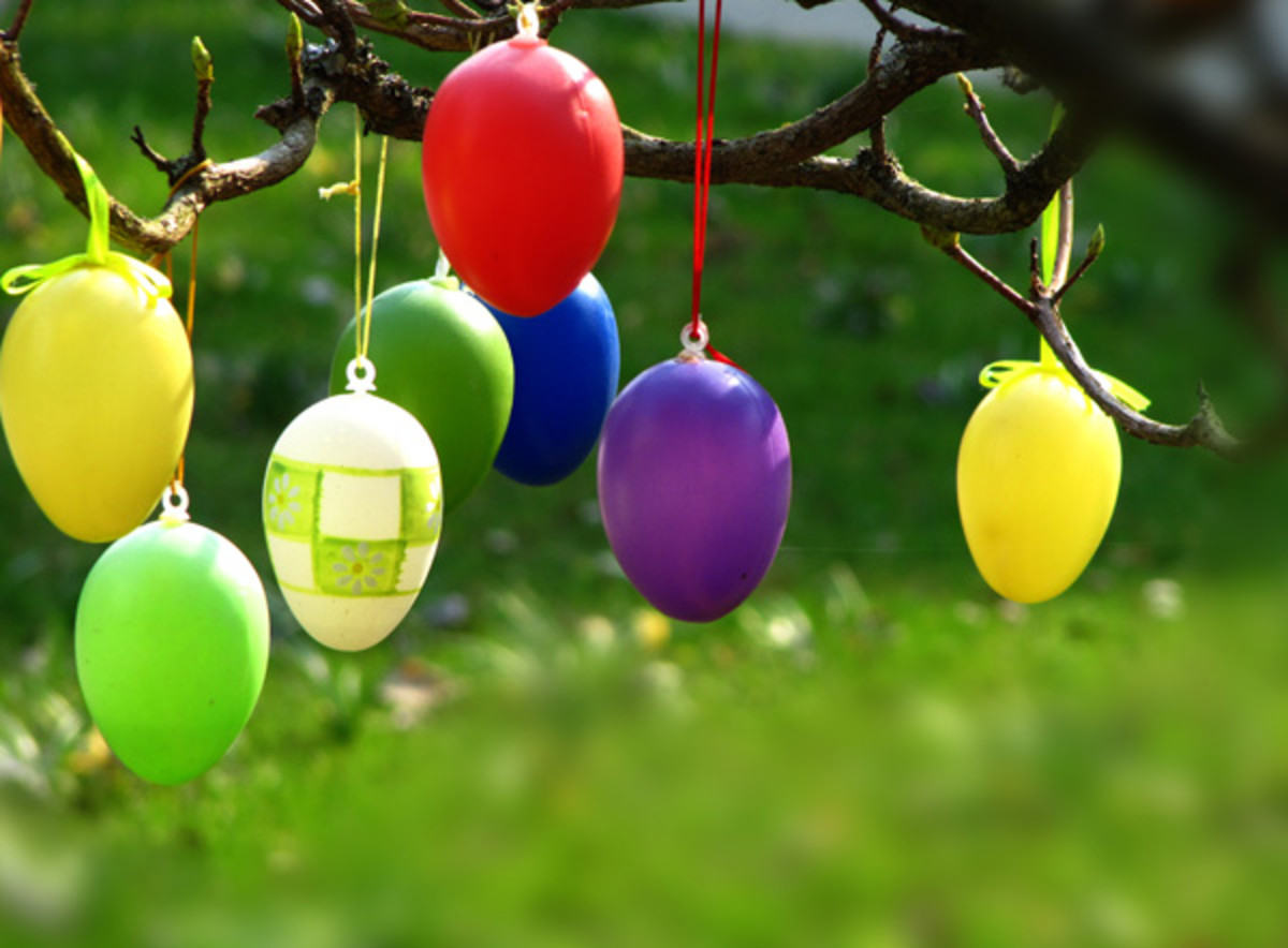 brightly colored eggs hanging from a German Easter tree