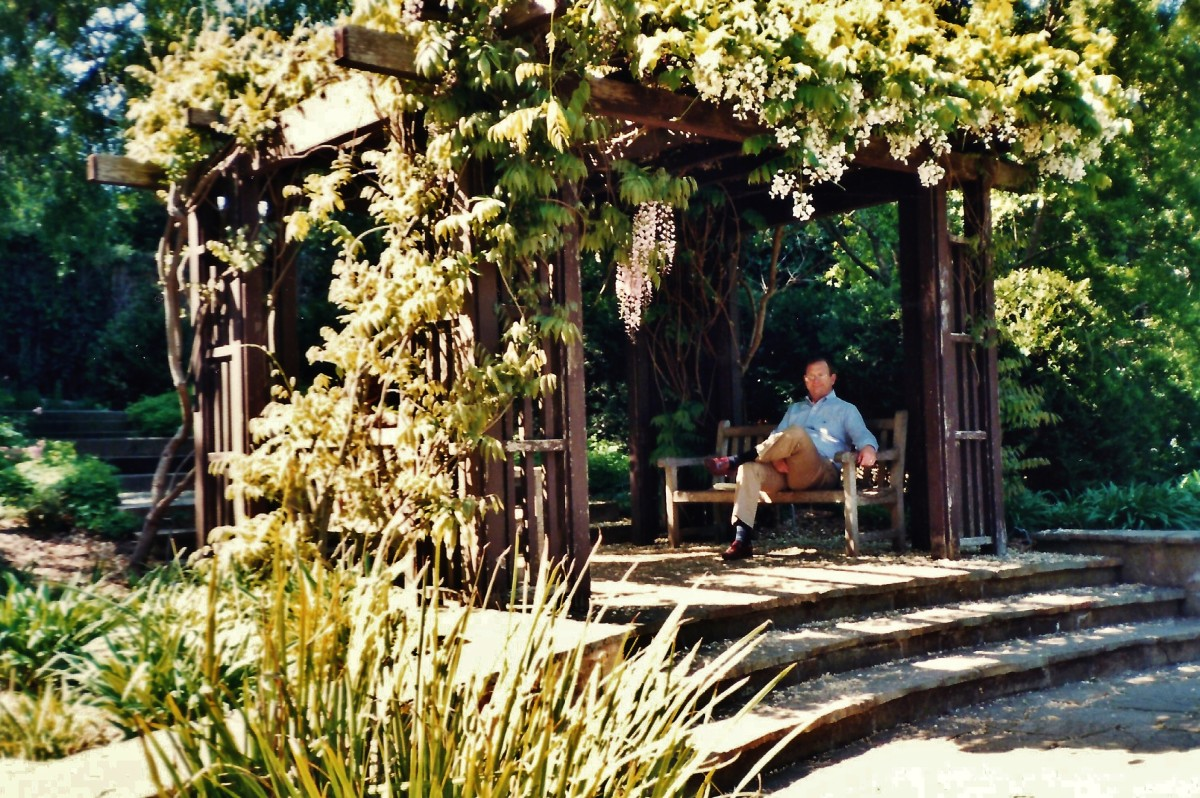 My hubby resting under an arbor.