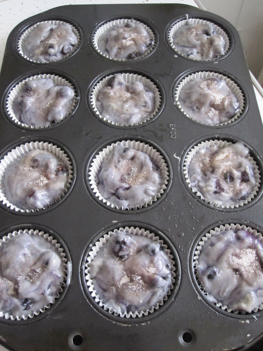 The muffin tins filled with batter.  Nutmeg sugar sprinkled on top.