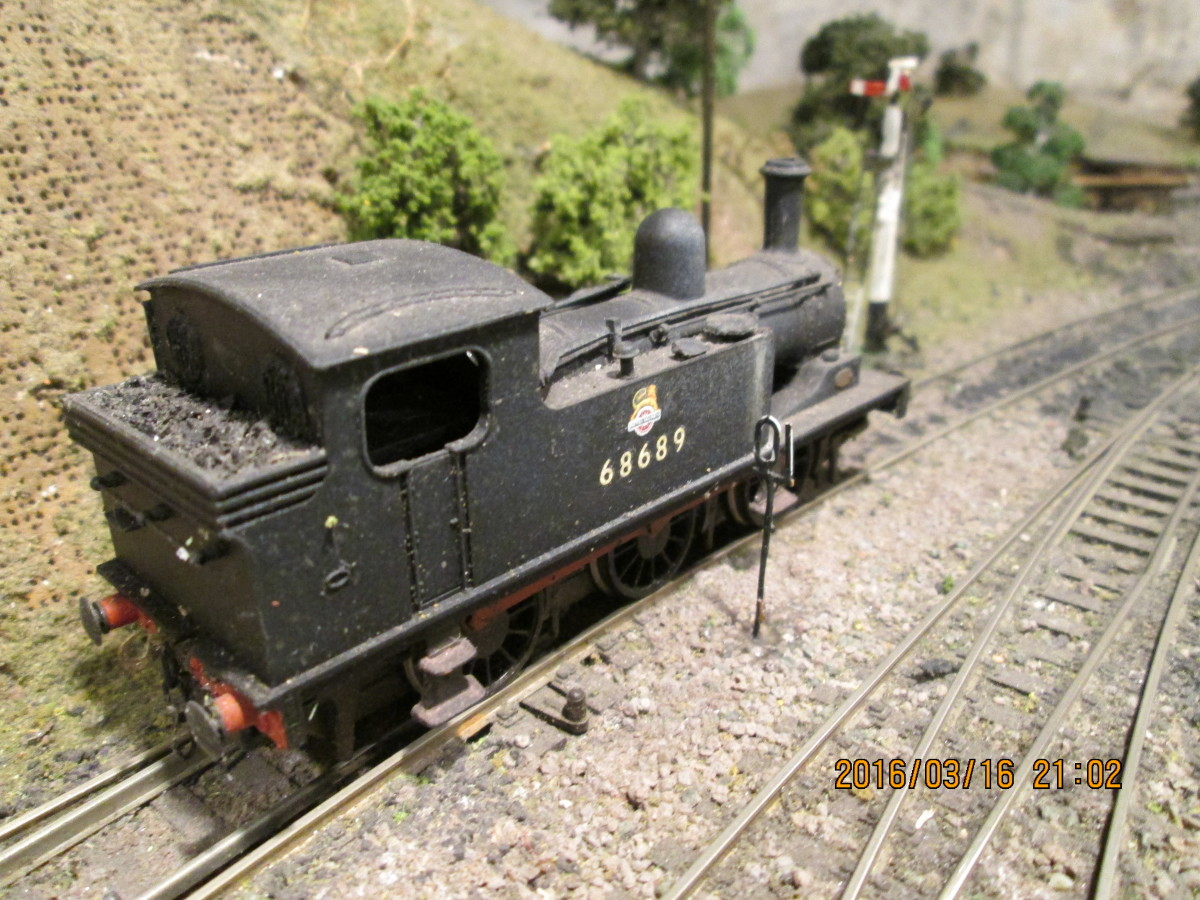Originally NER Class E1, LNER/BR Class J72  0-6-0T 68689 rests between duties at the goods depot starter, Thoraldby.  The model is available from Bachmann Branchline