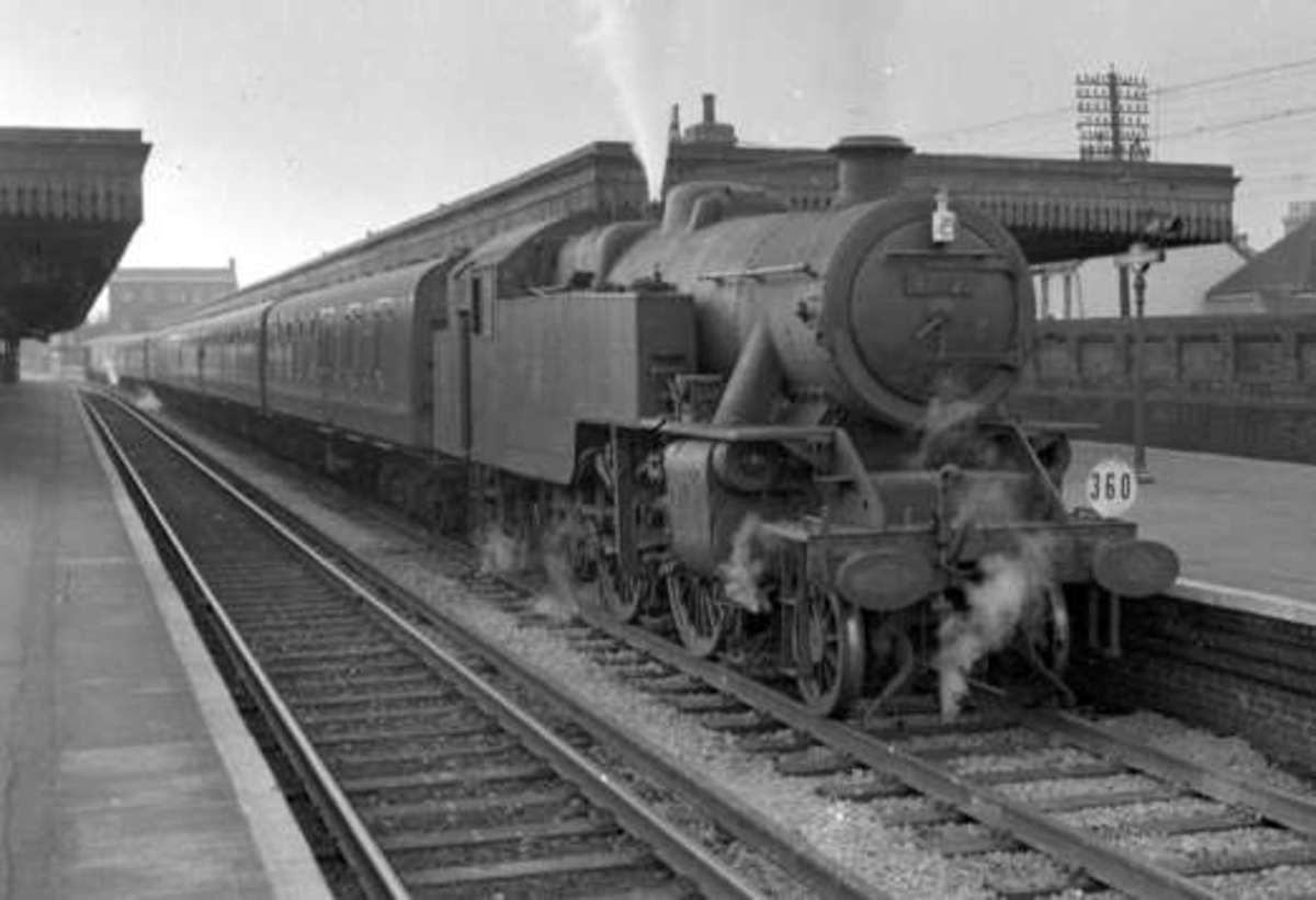 Fairburn 2-6-4T 42140 simmers with an excursion train in the Midlands