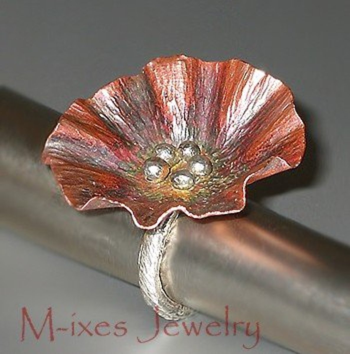 Marjorie of M-Ixes Jewelry finds Etsy a good place to sell her beautiful metalwork. (Oh and check out the banner by yours truly :P)