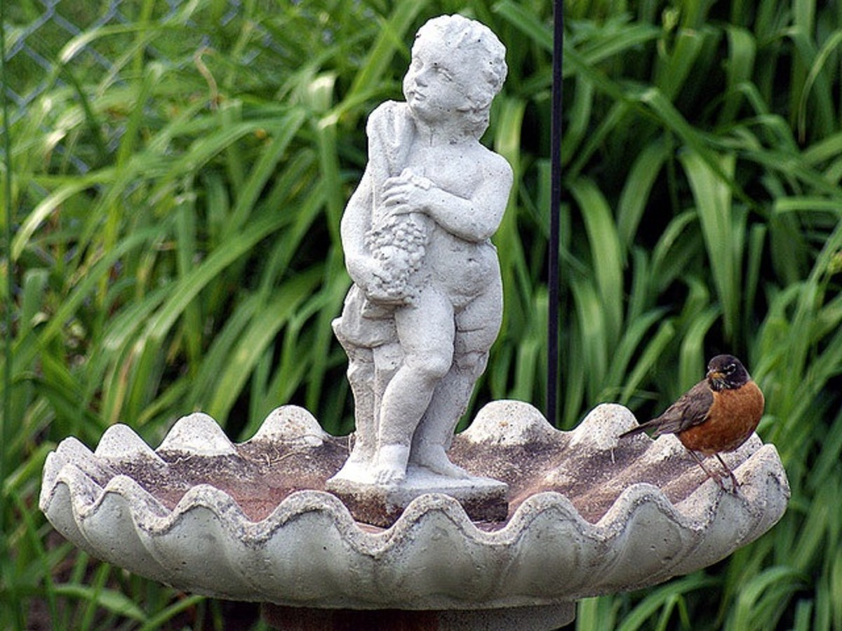 stone bird bath with statue