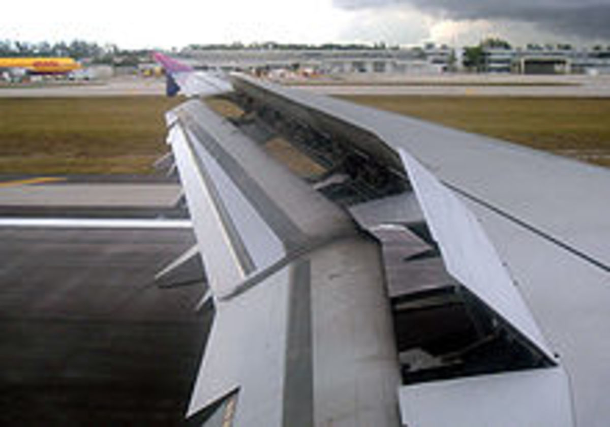 Spoiler upward and flaps downward extended