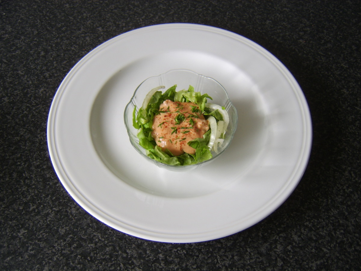 Paprika and chives are scattered on langoustine prawn cocktail