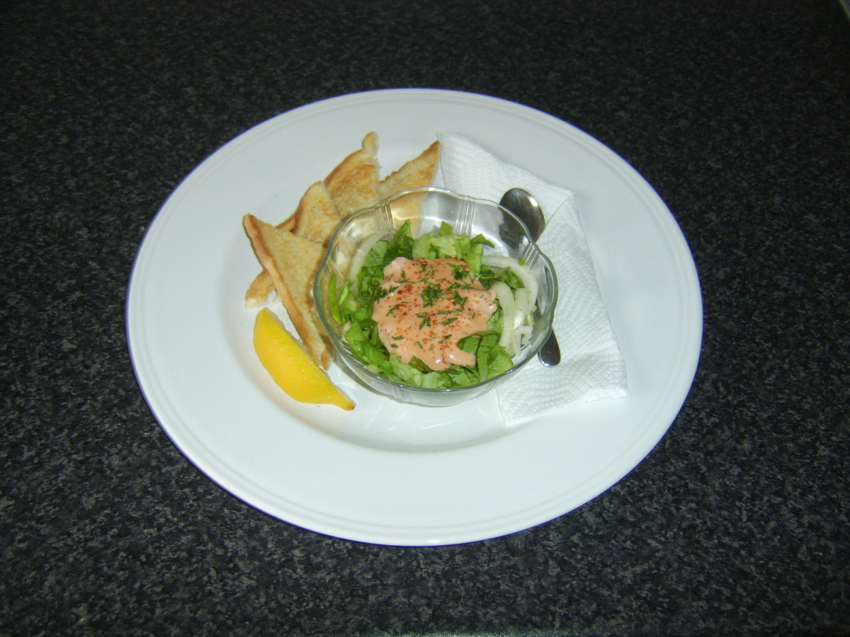 Langoustine tails are mixed with seafood sauce and served with a simple salad and hot toast
