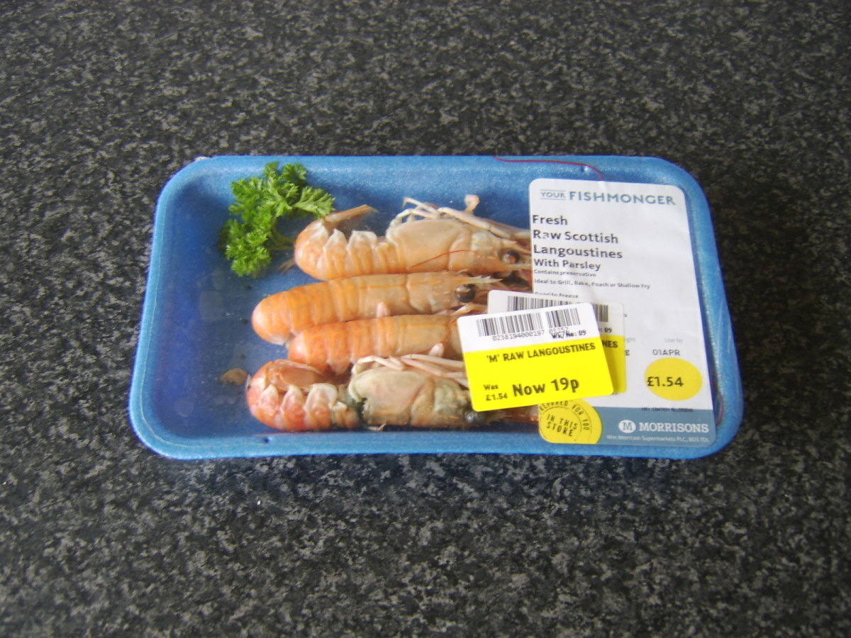 Unsold fresh langoustines, drastically reduced in price from £1.54 to £0.19 - an incredible bargain but a sad sign of consumer shopping patterns