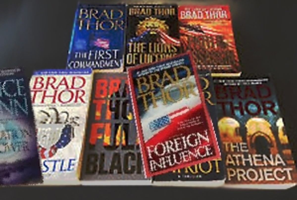 A few of my Brad Thor books at home