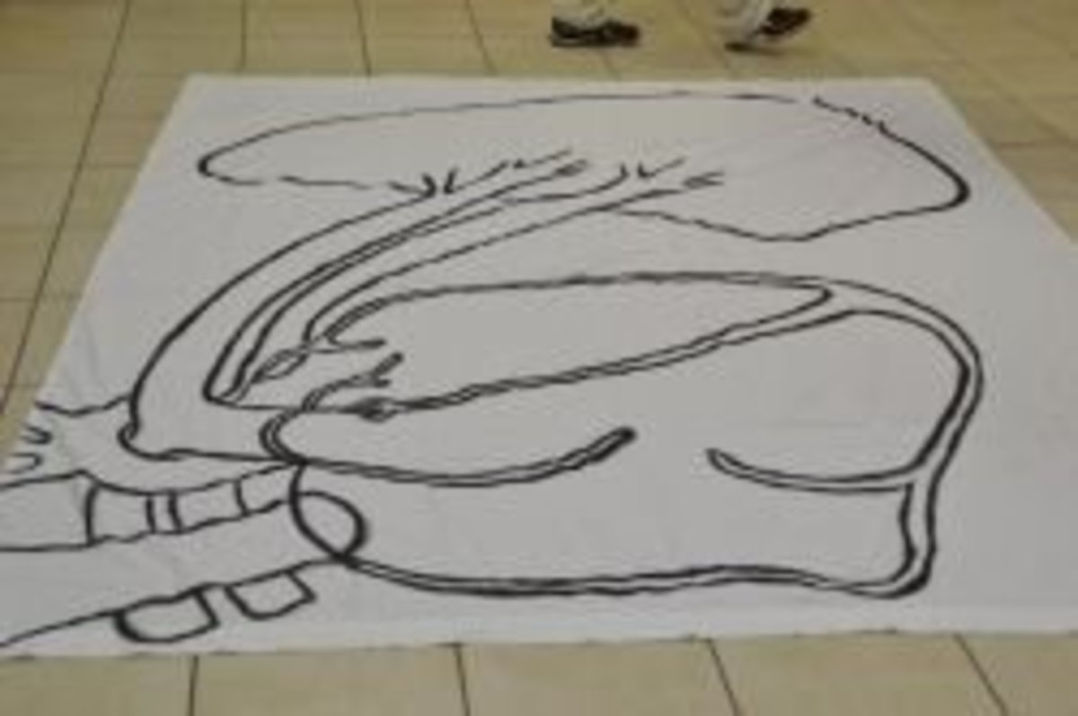 Bed sheet with the circulatory system drawn on it so children can walk through the system and name the parts.  (A chalk drawing on a driveway would also work.)
