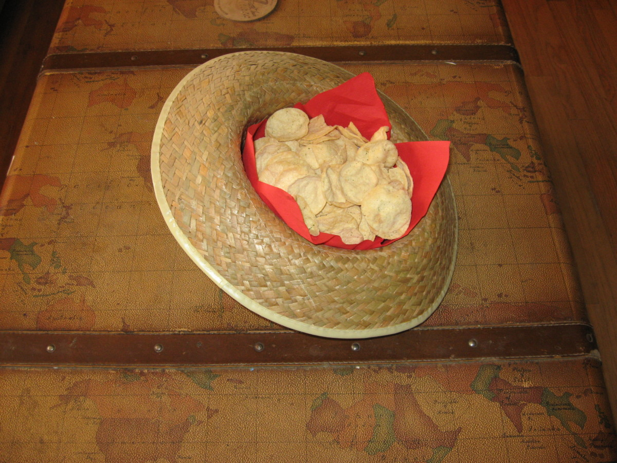 Western party supplies like hats can be used to serve chips and crackers.