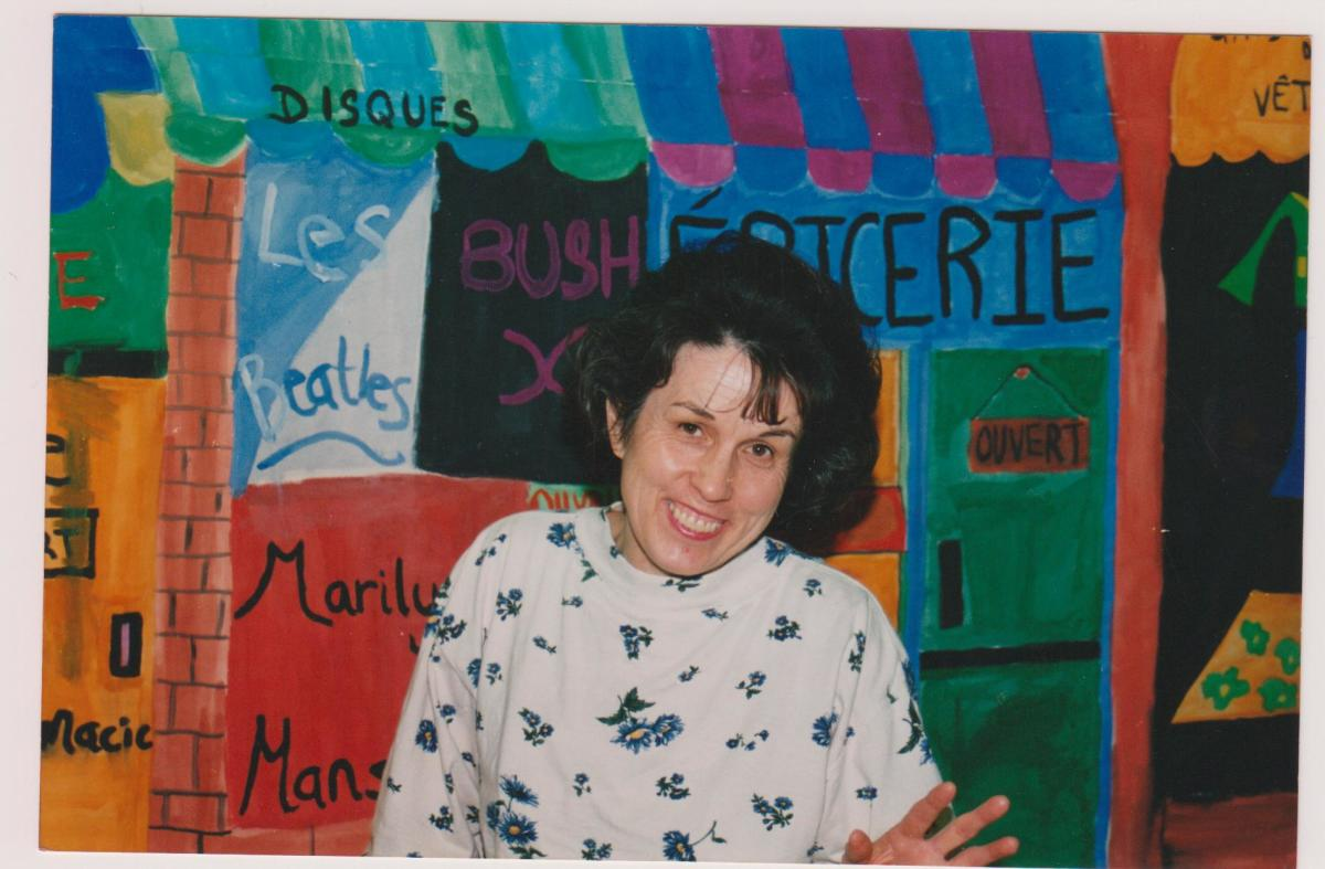 My Mom in front of an art project her students had done.