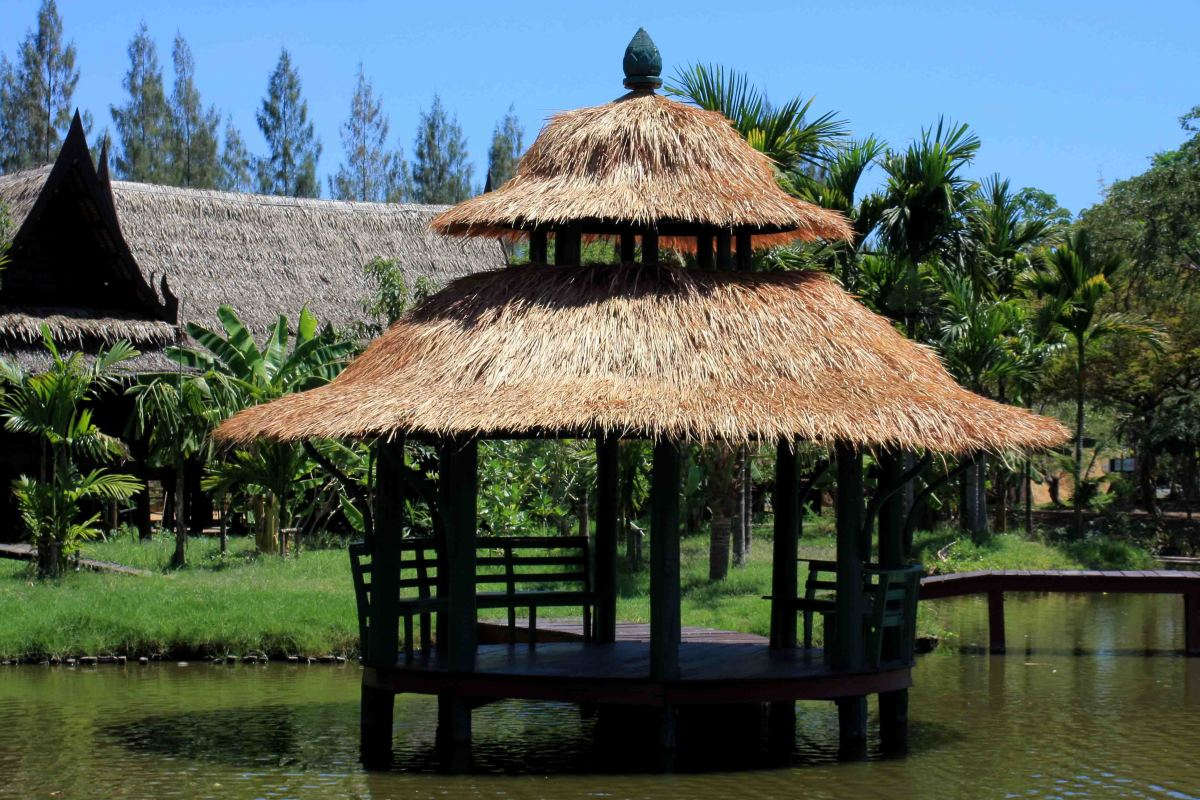 The exhibits of Muang Boran from the most extravagant to the simplest such as this shaded platform on the water, are all attractively designed and arranged in natural settings