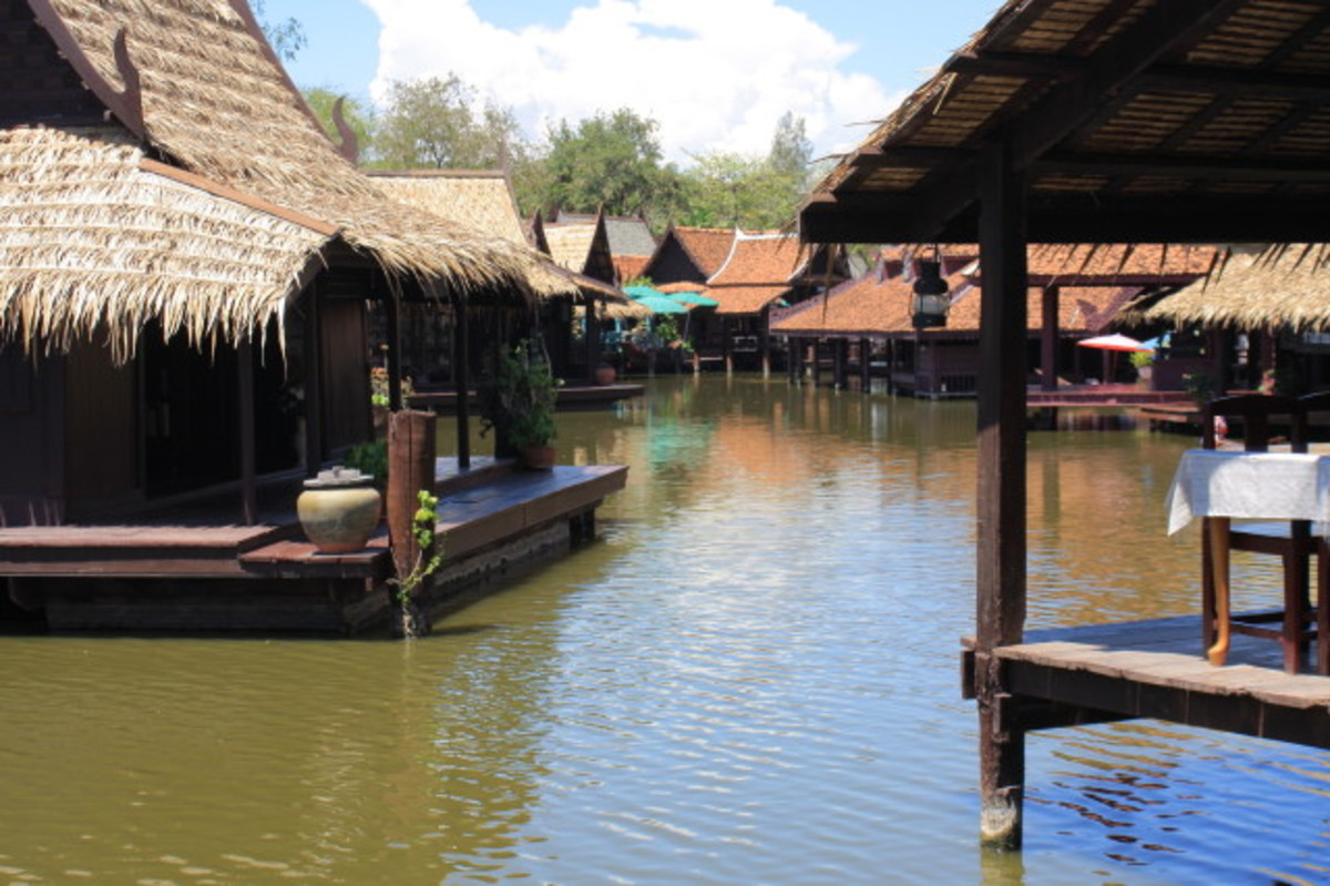 The riverside restaurants offer an attractive setting for lunch. One of the restaurant tables is just visible on the right of the picture