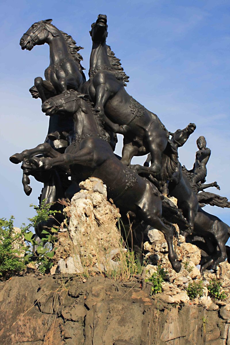 A 'Chariot of the Gods' drawn by horses riding through the sky - an impressive statue