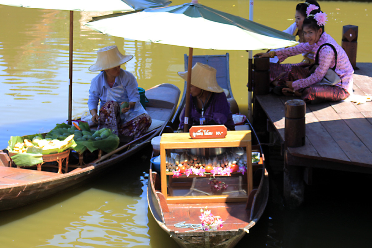 Boats representing the floating markets for which Thailand is famous