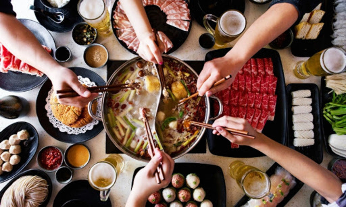 A group of people having hotpot