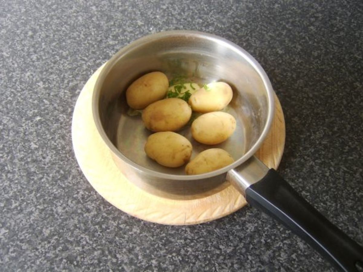 Butter and mint is added to potatoes