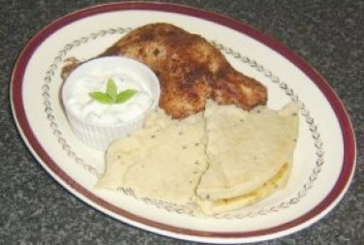 Tandoori Chicken Leg Portion with Naan Bread and Cucumber and Mint Raita