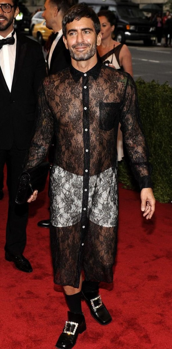 Marc Jacobs wearing a sheer black lace t-shirt dress by Comme des Garçons