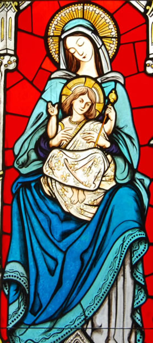 Mary holding Jesus in a Fleur-de-lis covered gown.