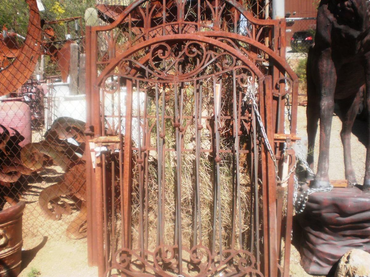 Need a rustic gate or a metal rattlesnake? Check out the inventory at The Town Dump.