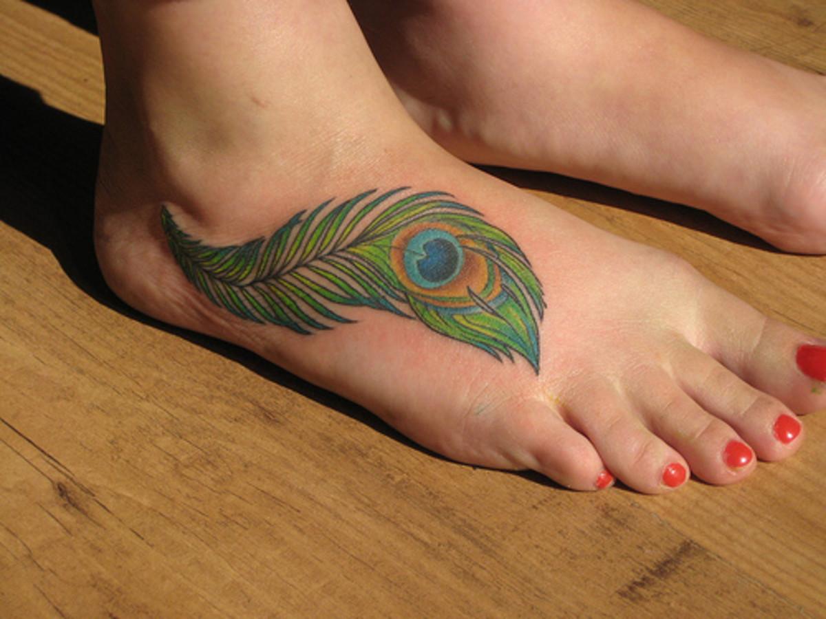 Peacock tattoo in foot