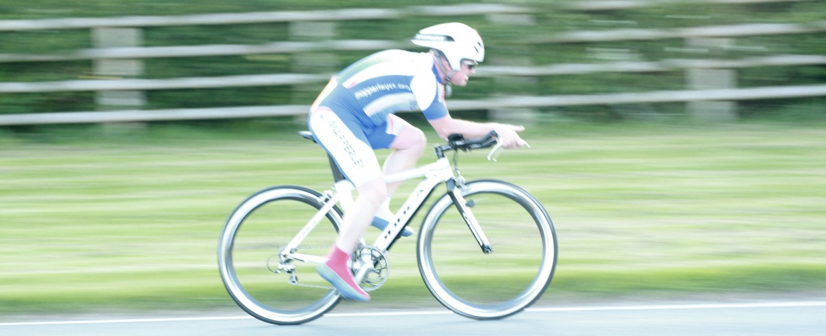 A cycling Panning Photo- following the cyclist in focus through the shutter trigger and release mechanism 1/60th sec, F4.0 ISO 400.
