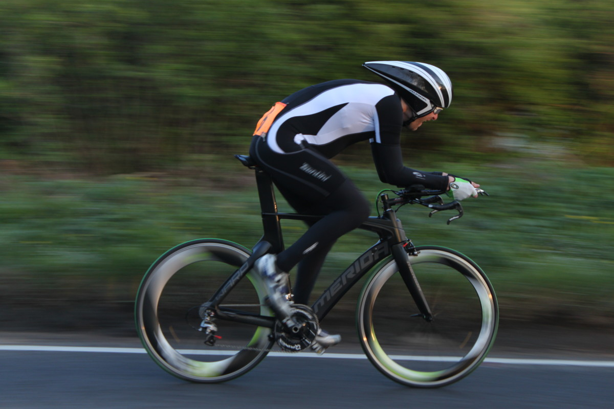 Play around with camera settings to blur the background in your cycling photo's. Shutter speed 1/60 sec, f value 5.6, ISO 200