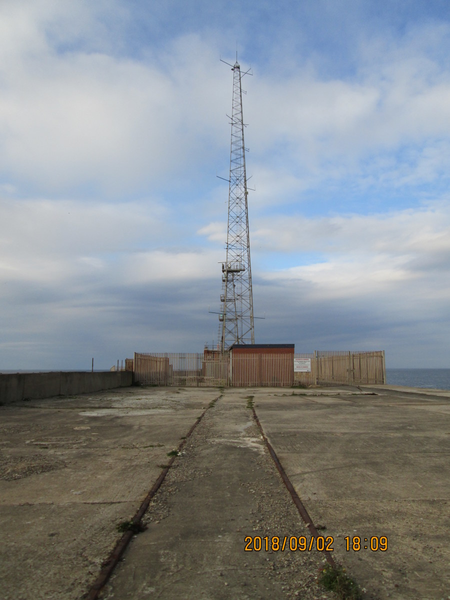 This is as much as there is to show at the end of the pier - breakwater to be exact. The beacon tower has gone, replaced by a radar tower and radio antenna. This is as far as you go, mate. Beyond the fence is 'no-go'. Off limits. Beyond that it's wet